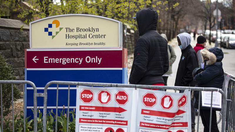 Local residents line up to be checked for possible effects of the coronavirus at a special tent in front of the Brooklyn Hospital Centers Emergency Room in Brooklyn, New York on April 2, 2020. (Robert Nickelsberg/Getty Images)