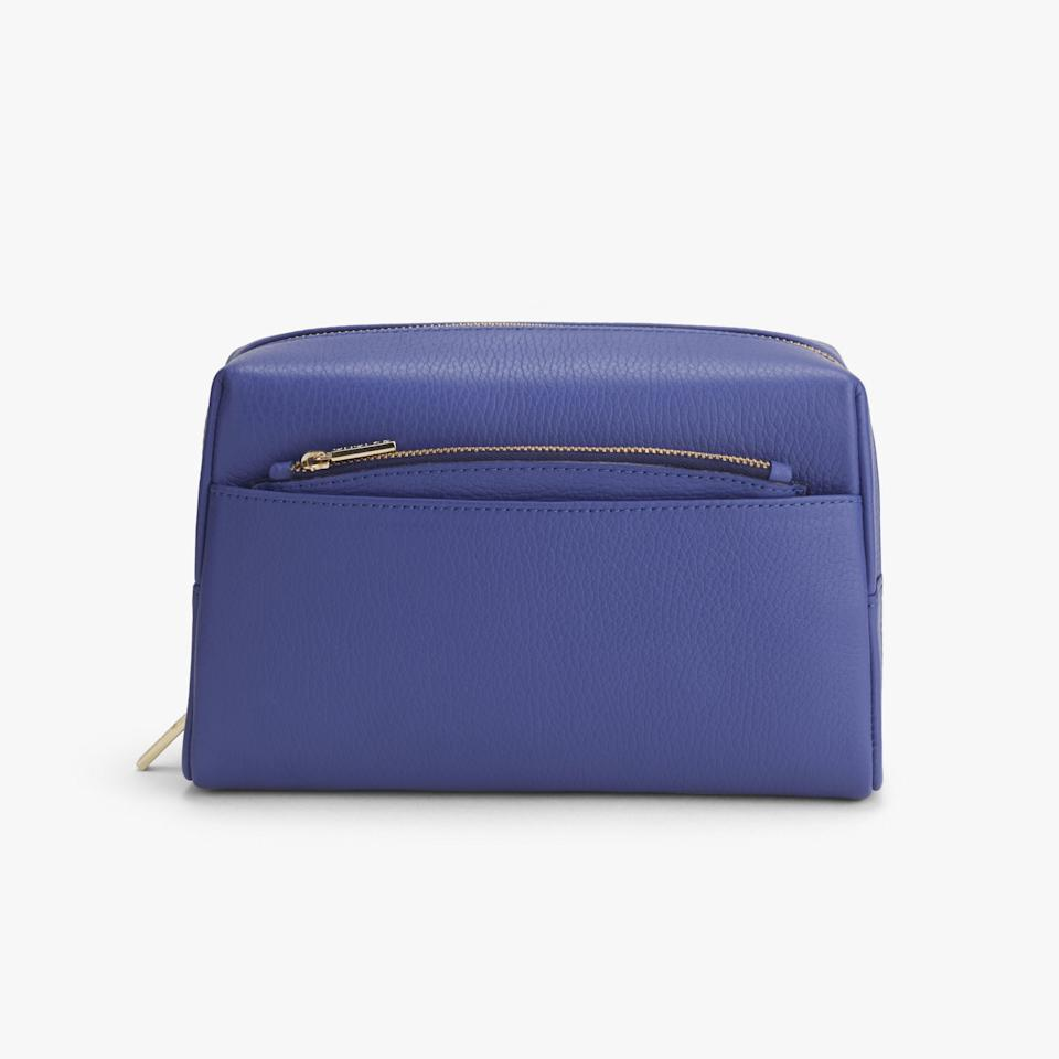 """<p>Major name-dropping alert: Meghan Markle has one of these <a rel=""""nofollow"""" href=""""https://www.allure.com/story/cuyana-daniel-martin-vanity-case?mbid=synd_yahoo_rss"""">chic-yet-practical travel cases</a>, designed by makeup artist Daniel Martin (who did <a rel=""""nofollow"""" href=""""https://www.allure.com/story/meghan-markle-hair-makeup-royal-wedding-photos?mbid=synd_yahoo_rss"""">her makeup for her wedding</a>, NBD). His collaboration with fashion-and-accessories brand Cuyana resulted in a travel makeup bag that not only looks pretty but <em>actually</em> holds all of your makeup.</p> <p><strong>$110 (<a rel=""""nofollow"""" href=""""https://www.cuyana.com/stories/cuyana-x-daniel-martin.html"""">Shop Now</a>)</strong></p>"""