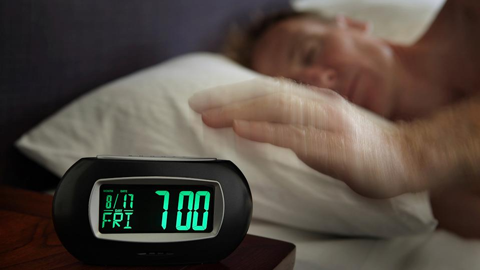 Getting up at the same time every day will help create good sleep patterns (Image: Getty Images)