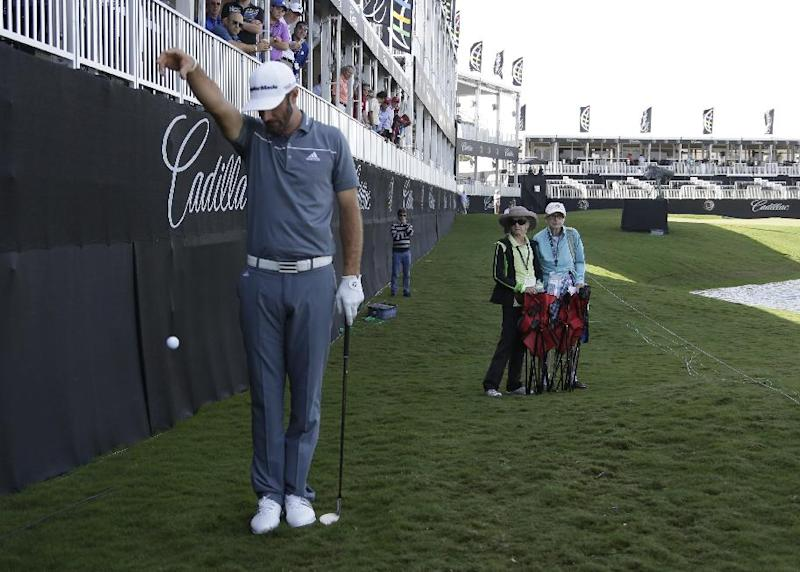 Dustin Johnson takes a drop on the ninth hole rough during the first round of the Cadillac Championship golf tournament Friday, March 7, 2014, in Doral, Fla. A severe thunderstorm delayed first round play on Thursday. (AP Photo/Lynne Sladky)