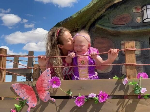 Seven-year-old Bella is on the list for a bowel transplant. Her wish for a backyard playhouse came true in early May.