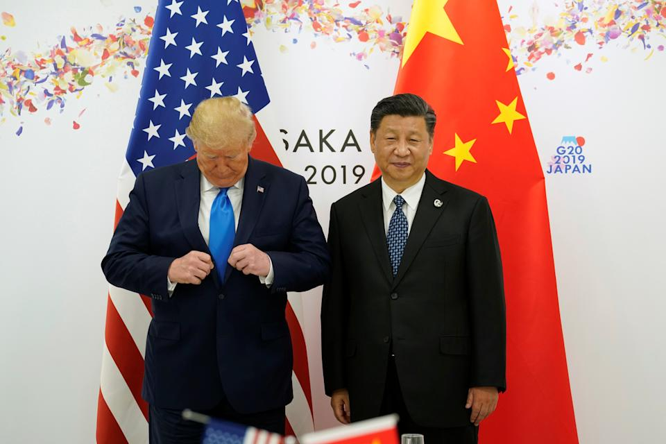 U.S. President Donald Trump and China's President Xi Jinping pose for a photo ahead of their bilateral meeting during the G20 leaders summit in Osaka, Japan, June 29, 2019. REUTERS/Kevin Lamarque