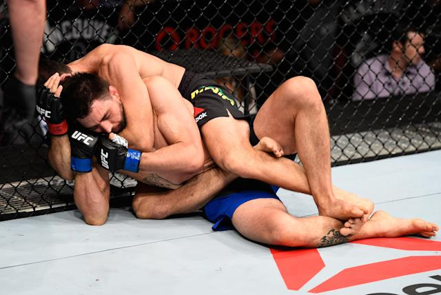 Carlos Condit is caught in a rear naked choke by Demian Maia on Aug. 27, 2016, and eventually submits. (Getty Images)