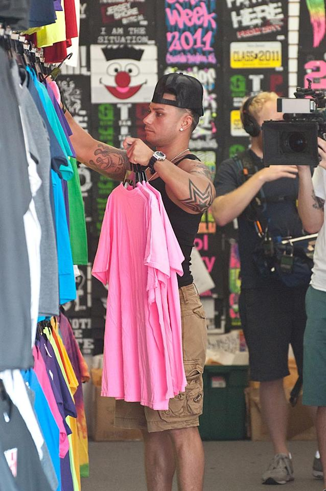 "All eyes -- and cameras -- were on Pauly D as he intently stocked the shop's racks with merchandise. Thelonius/<a href=""http://www.splashnewsonline.com"" target=""new"">Splash News</a> - July 6, 2011"