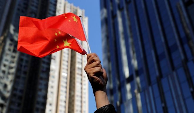 Hundreds of pro-Beijingers waved Chinese national flags during the rally. Photo: Reuters