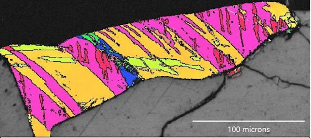 The team used a technique called electron backscatter diffraction to discover the former presence of cubic zirconia, a mineral phase that would only occur in rocks heated to above 2300C. (PA)