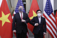 U.S. Secretary of State Mike Pompeo, left, and Vietnamese Foreign Minister Pham Binh Minh pose for a photo before a meeting in Hanoi, Vietnam, Friday, Oct. 30, 2020. Pompeo is wrapping up an anti-China tour of Asia in Vietnam as the fierce American presidential election race enters its final stretch. (Bui Lam Khanh/VNA via AP)