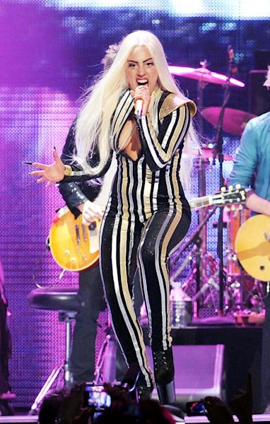 FILE - This Dec. 15, 2012 file photo shows singer Lady Gaga performing at the Prudential Center in Newark, N.J. Live Nation Global Touring announced on Wednesday, Feb. 13, 2013 that the singer has canceled the remainder of her tour due to a hip injury that will require surgery. (Photo by Evan Agostini/Invision/AP, file)