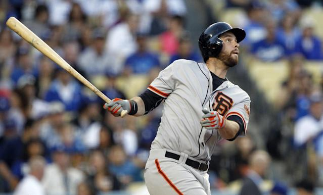 San Francisco Giants' Brandon Belt watches his solo home run in the sixth inning of a baseball game against the Los Angeles Dodgers on Sunday, April 6, 2014, in Los Angeles. (AP Photo/Alex Gallardo)