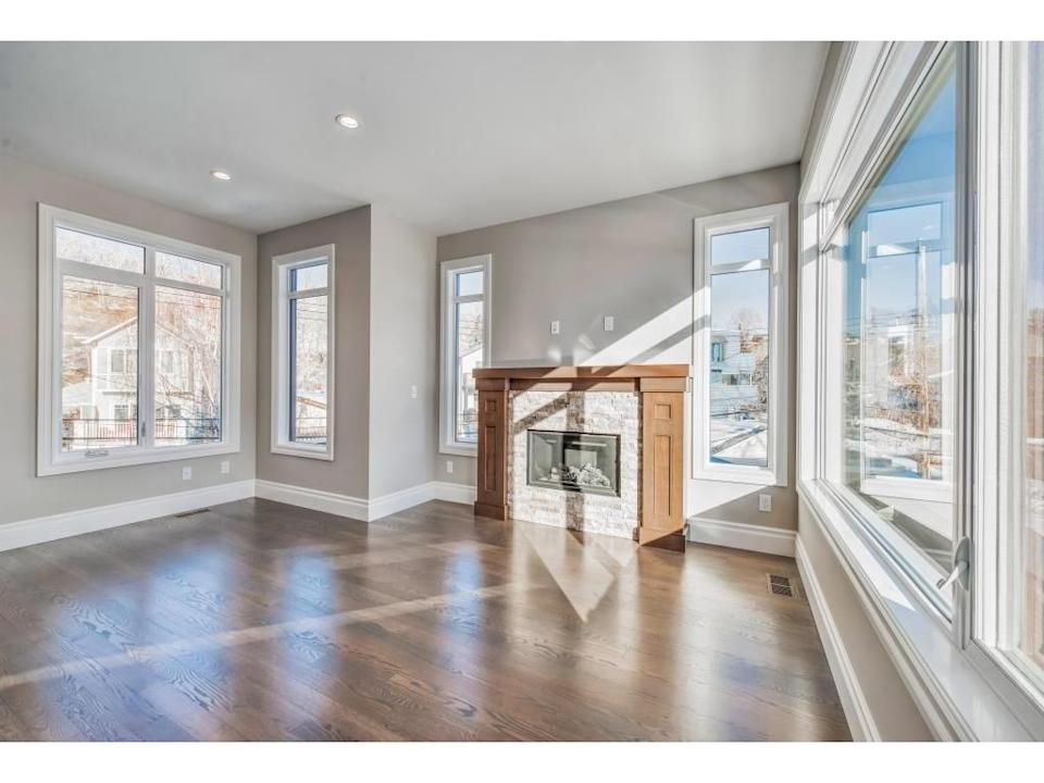 <p><span>616 3 Avenue Northwest, Calgary, Alta.</span><br> This three-storey townhouse has an open living room with views of the neighbouring park.<br> (Photo: Zoocasa) </p>