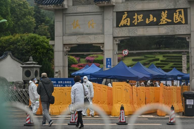 Hazmat-suit-wearing security personnal and police were present at Wuhan's Biandanshan Cemetary as people filed past to lay their loved ones to rest