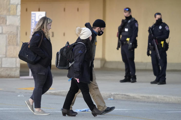 FBI officials walk to the Mayfair Mall, Friday, Nov. 20, 2020, in Wauwatosa, Wis. Multiple people were shot Friday afternoon at the mall. Wauwatosa Mayor Dennis McBride says in a statement that a suspect remains at large after the shooting at Mayfair Mall. (AP Photo/Nam Y. Huh)