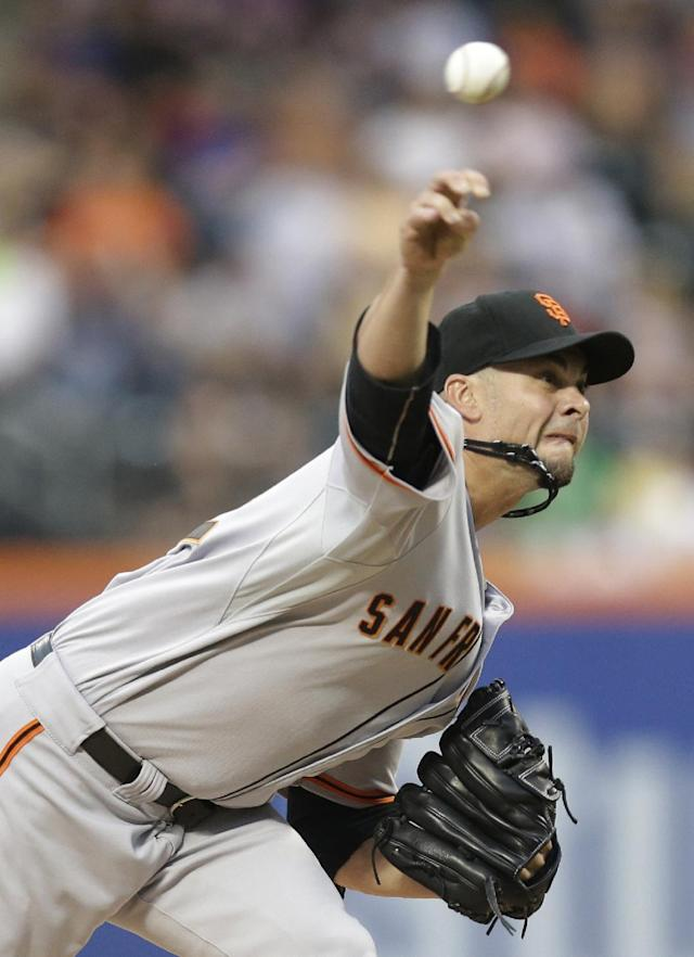 San Francisco Giants' Ryan Vogelsong delivers a pitch during the first inning of a baseball game against the New York Mets on Friday, Aug. 1, 2014, in New York. (AP Photo/Frank Franklin II)