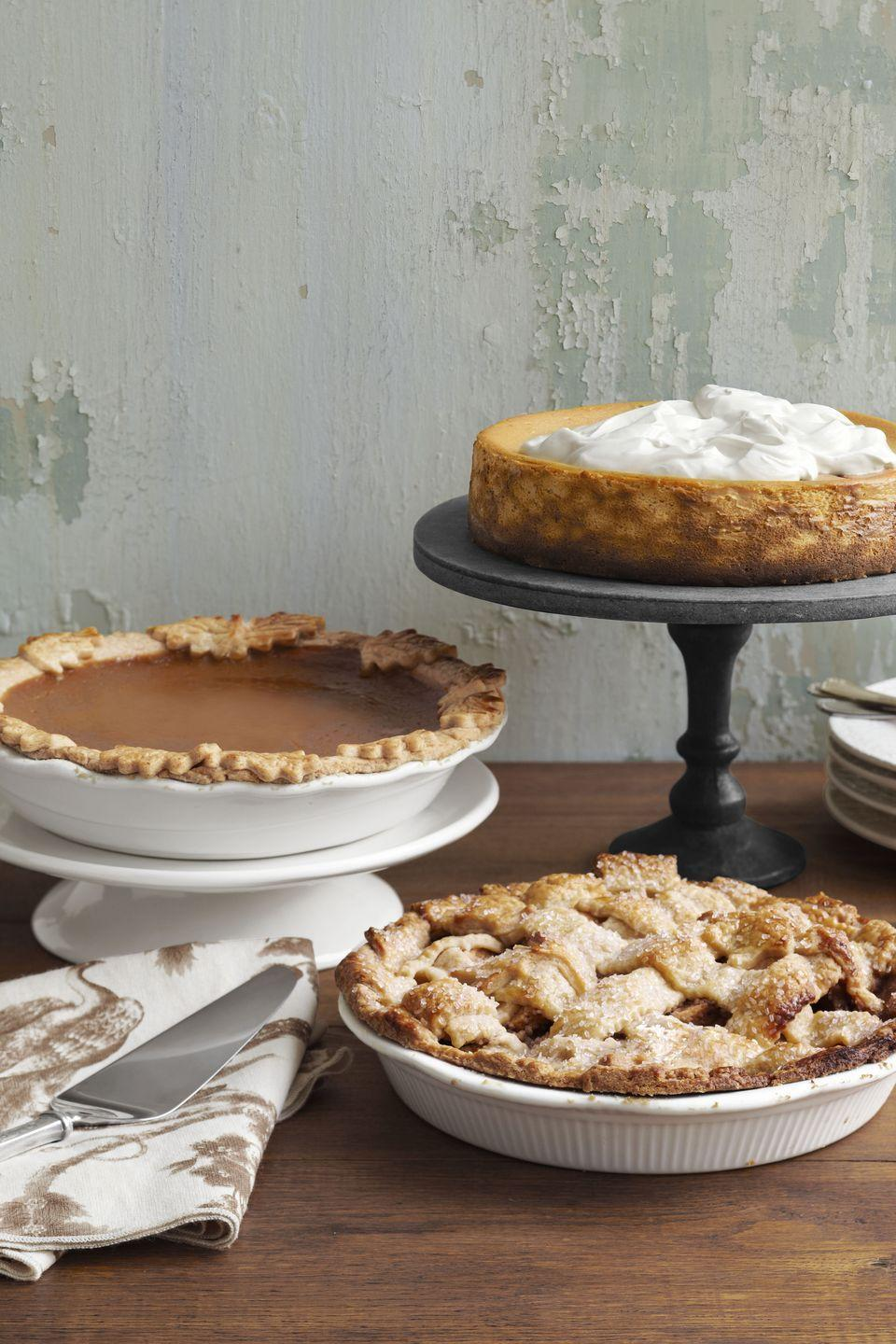 """<p><em>Far Left:</em> """"We use half lard, half butter for our sweet-potato pie dough,"""" notes Josh Kilmer-Purcell of <a href=""""https://go.redirectingat.com?id=74968X1596630&url=http%3A%2F%2Fbeekman1802.com%2F&sref=https%3A%2F%2Fwww.countryliving.com%2Ffood-drinks%2Fg1368%2Fthanksgiving-pies%2F"""" rel=""""nofollow noopener"""" target=""""_blank"""" data-ylk=""""slk:Bekman 1802"""" class=""""link rapid-noclick-resp"""">Bekman 1802</a>, """"but straight-up butter works, too.""""</p><p><em>Bottom:</em> Thick slices of Granny Smith and Macintosh apples — tossed with rosemary, honey, and cinnamon—nestle beneath a rustic lattice crust.</p><p><strong>Recipes:</strong></p><p><strong><a href=""""https://www.countryliving.com/food-drinks/recipes/a3900/sour-cream-sweet-potato-pie-recipe-clx1111/"""" rel=""""nofollow noopener"""" target=""""_blank"""" data-ylk=""""slk:Sour Cream-Sweet Potato Pie"""" class=""""link rapid-noclick-resp"""">Sour Cream-Sweet Potato Pie</a></strong></p><p><strong><a href=""""https://www.countryliving.com/food-drinks/recipes/a3896/apple-pie-rosemary-honey-recipe-clx1111/"""" rel=""""nofollow noopener"""" target=""""_blank"""" data-ylk=""""slk:Apple Pie with Rosemary and Honey"""" class=""""link rapid-noclick-resp"""">Apple Pie with Rosemary and Honey</a></strong></p>"""