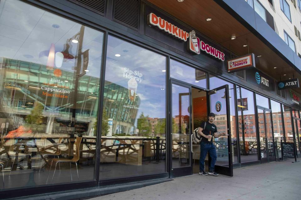 FILE - In this June 12, 2019, file photo a customer leaves a Dunkin' Donuts store in Harrison, N.J. Dunkin' Brands Group Inc. reports financial earns on Thursday, Oct. 31. (AP Photo/Mary Altaffer, File)