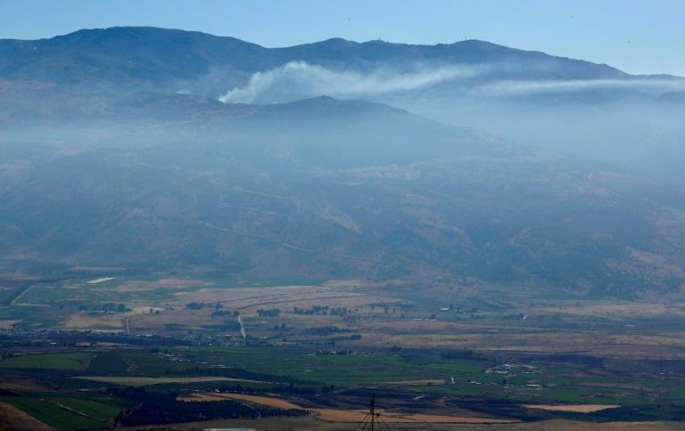 Smoke billows from a southern Lebanese border village following overnight Israeli shelling after rockets were fired from Lebanon into Israel