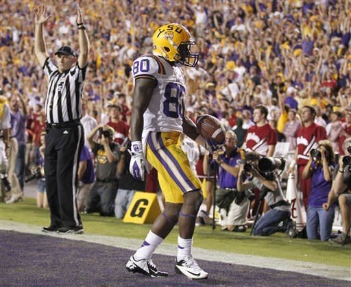 LSU Tigers wide receiver Jarvis Landry (80) celebrates catching a touchdown pass against Alabama during the fourth quarter of an NCAA college football game in Baton Rouge, La., Saturday, Nov. 3, 2012. (AP Photo/Bill Haber)