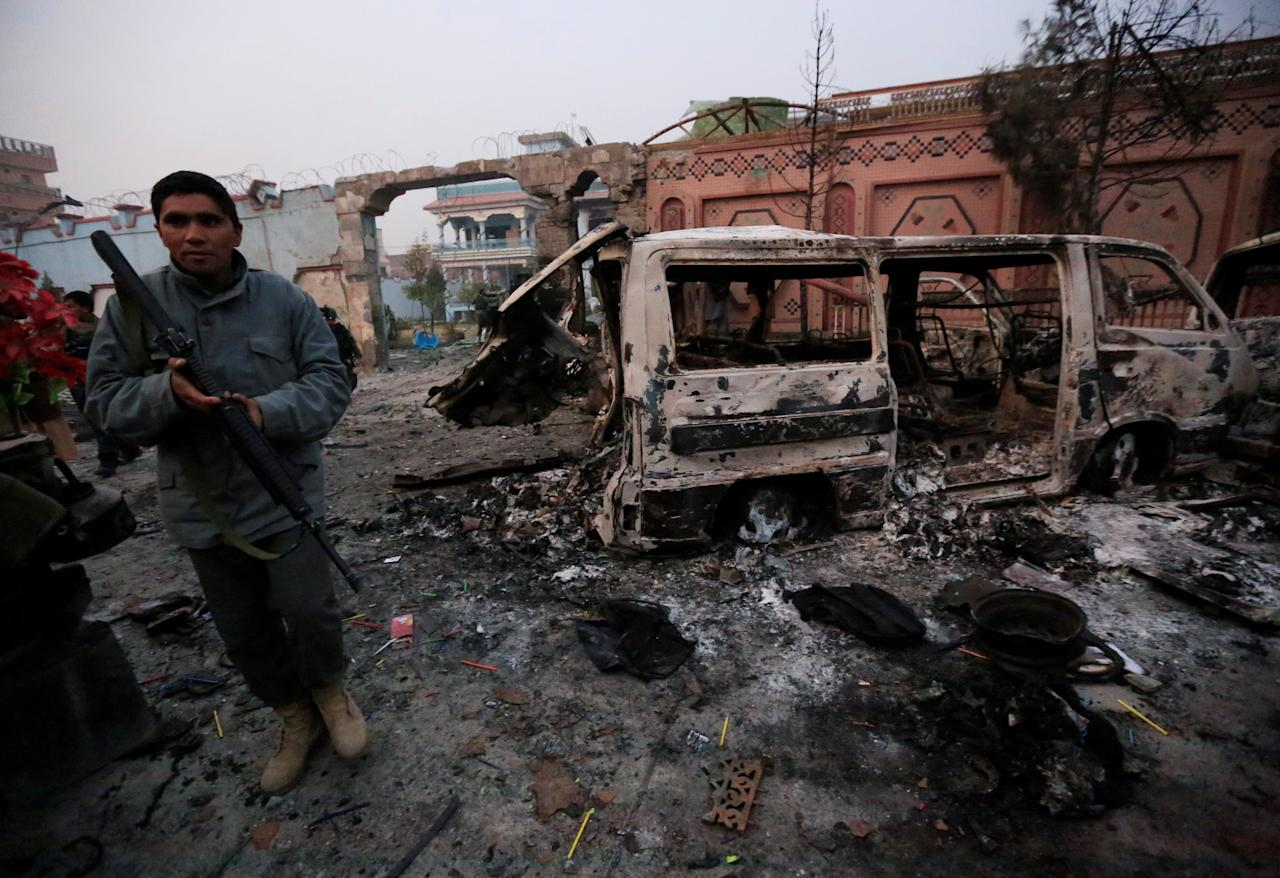 <p>An Afghan policeman inspects the site of a blast in Jalalabad, Afghanistan, Jan. 24, 2018. (Photo: Parwiz/Reuters) </p>