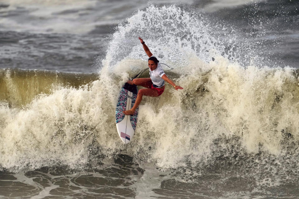 FILE - In this July 27, 2021, file photo, Carissa Moore, of the United States, preforms on the wave during the gold medal heat in the women's surfing competition at the 2020 Summer Olympics at Tsurigasaki beach in Ichinomiya, Japan. Still riding a big wave from their sport's Olympic debut, the world's top five women and men gather at Southern California's revered Lower Trestles to contest the one-day, winner-take-all Rip Curl WSL Finals. (AP Photo/Francisco Seco, File)