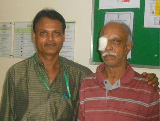 Indian doctor V. Seetharaman (left) is seen with his patient P.K. Krishnamurthy after Seetharaman removed a 13-centimetre live worm from Krishnamurthy's eye at a hospital in Mumbai this week. Seetharaman said the worm may be a record-breaking size
