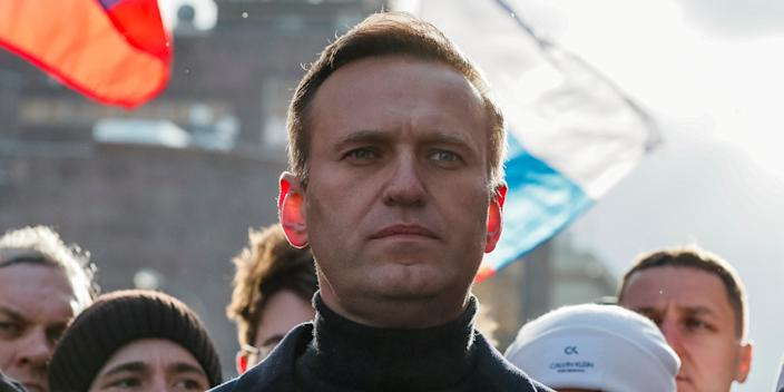 FILE PHOTO: Russian opposition politician Alexei Navalny takes part in a rally to mark the 5th anniversary of opposition politician Boris Nemtsov's murder and to protest against proposed amendments to the country's constitution, in Moscow, Russia February 29, 2020. REUTERS/Shamil Zhumatov