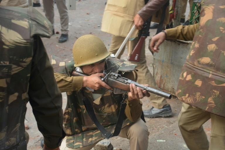 Police in Meerut, Uttar Pradesh, take aim at angry crowds demonstrating against the citizenship law (AFP Photo/STR)