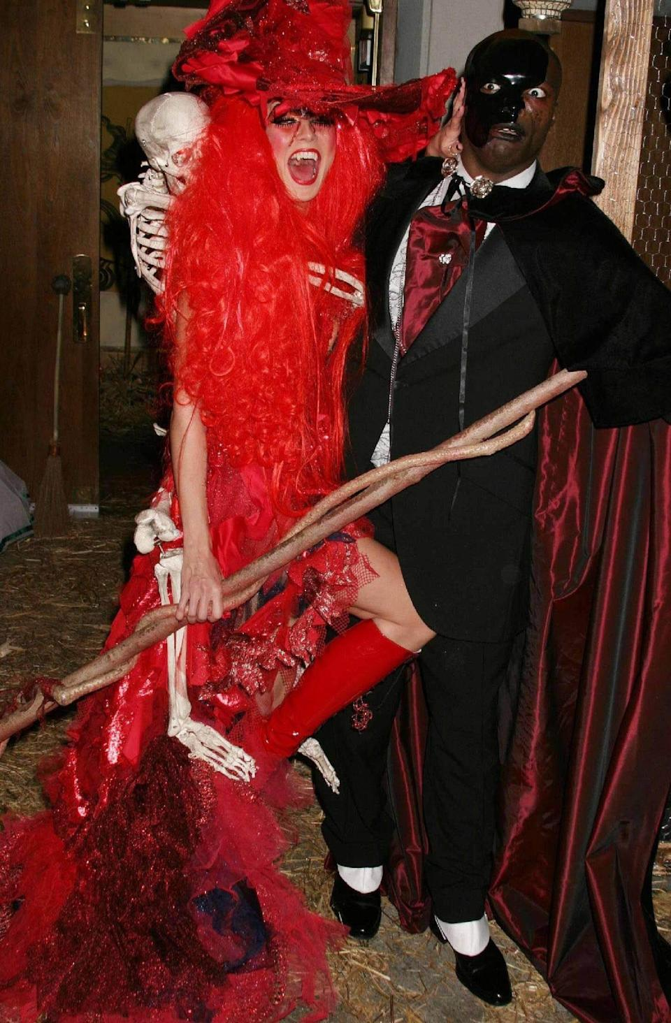 Heidi Klum, pictured with Seal, dresses as a witch for her 2004 Halloween party. - Credit: PNP/WENN/Newscom/MEGA
