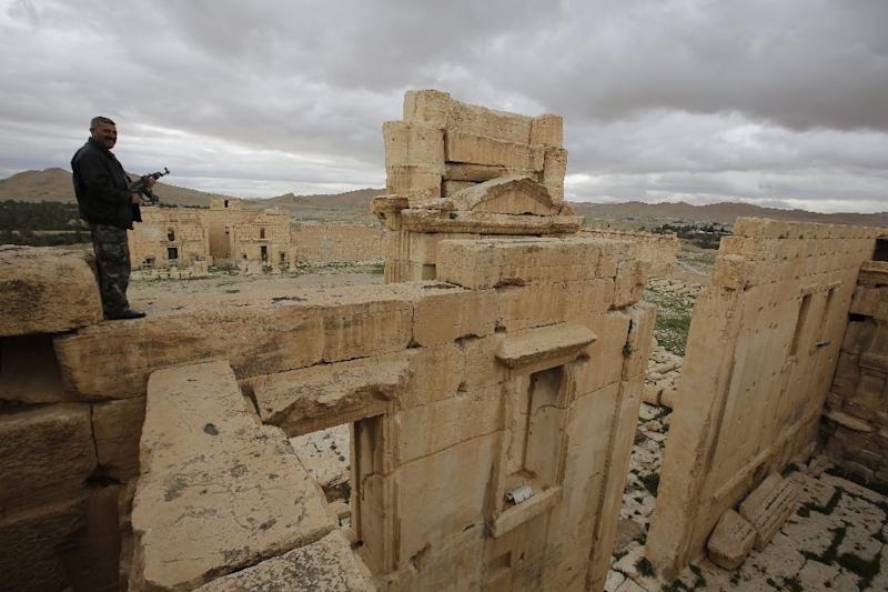 A Syrian policeman stands on the sanctury of Baal in the ancient oasis city of Palmyra, 215 kilometres northeast of Damascus, in March 2014