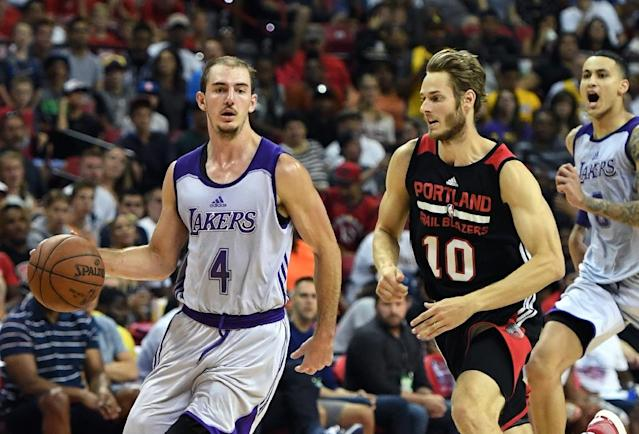 Alex Caruso of the Los Angeles Lakers drives ahead of Jake Layman of the Portland Trail Blazers during the championship game of the 2017 Summer League, at the Thomas & Mack Center in Las Vegas, Nevada, on July 17 (AFP Photo/Ethan Miller)