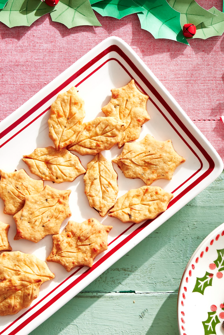 """<p>Sure, you could go the store-bought route. But if you really want to impress your guests this year, opt for these homemade crackers instead. They're loaded with sharp Cheddar and fresh black pepper. Yum!</p><p><strong><a href=""""https://www.countryliving.com/food-drinks/a29640457/cheddar-holly-crackers-recipe/"""" rel=""""nofollow noopener"""" target=""""_blank"""" data-ylk=""""slk:Get the recipe"""" class=""""link rapid-noclick-resp"""">Get the recipe</a>.</strong> </p>"""