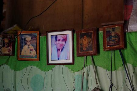 Pictures of the late Bernabe Sabangan, when he was a teenager and a baby, are seen on display at his family's house in Barangay Bagong Silangan in Quezon City, Metro Manila, Philippines November 28, 2017. REUTERS/Erik De Castro NO RESALES. NO ARCHIVES