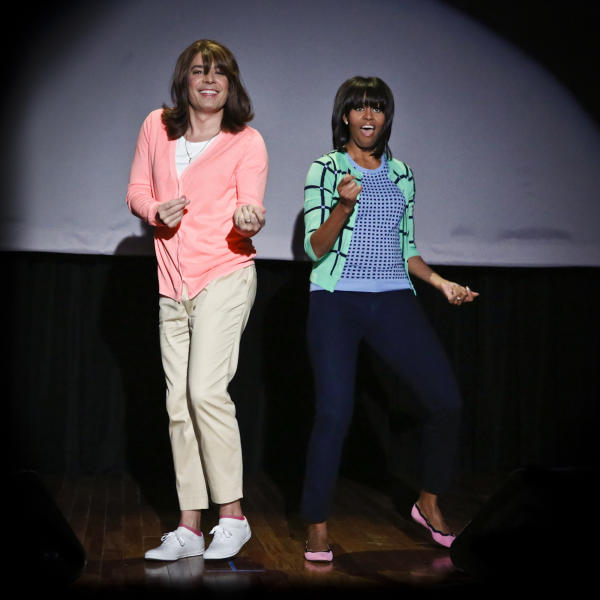 "This image released by NBC shows host Jimmy Fallon dressed as a mom, left, dancing with first lady Michelle Obama during an appearance of ""Late Night with Jimmy Fallon,"" Friday, Feb. 22, 2013 in New York. Obama returned to the show to promote her ""Let's Move"" campaign and to perform in a skit called ""Evolution of Mom Dancing."" (AP Photo/NBC, Lloyd Bishop)"