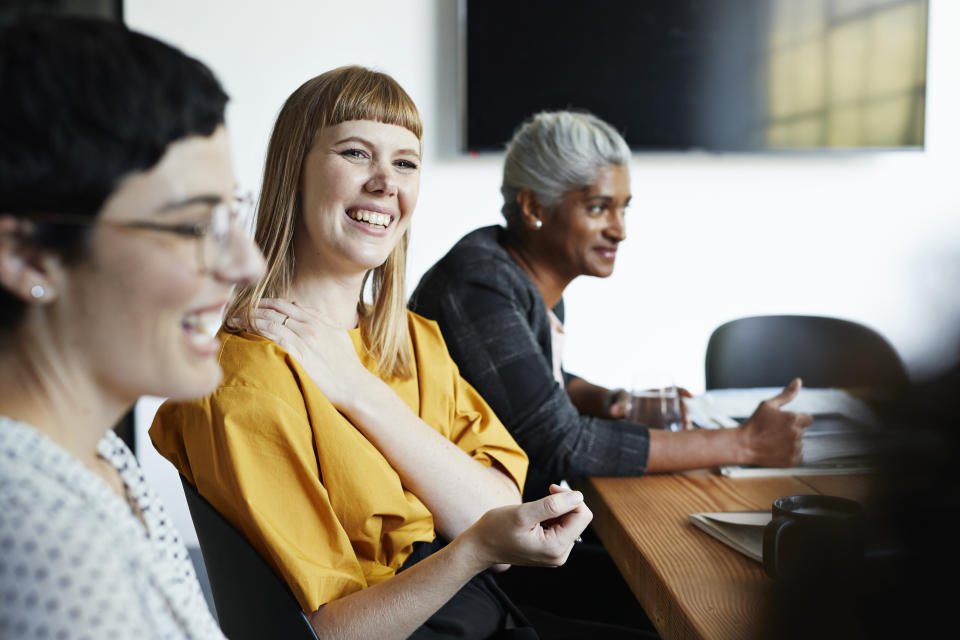 Studies have repeatedly found that working alongside other people has a positive impact on our working day. Photo: Getty