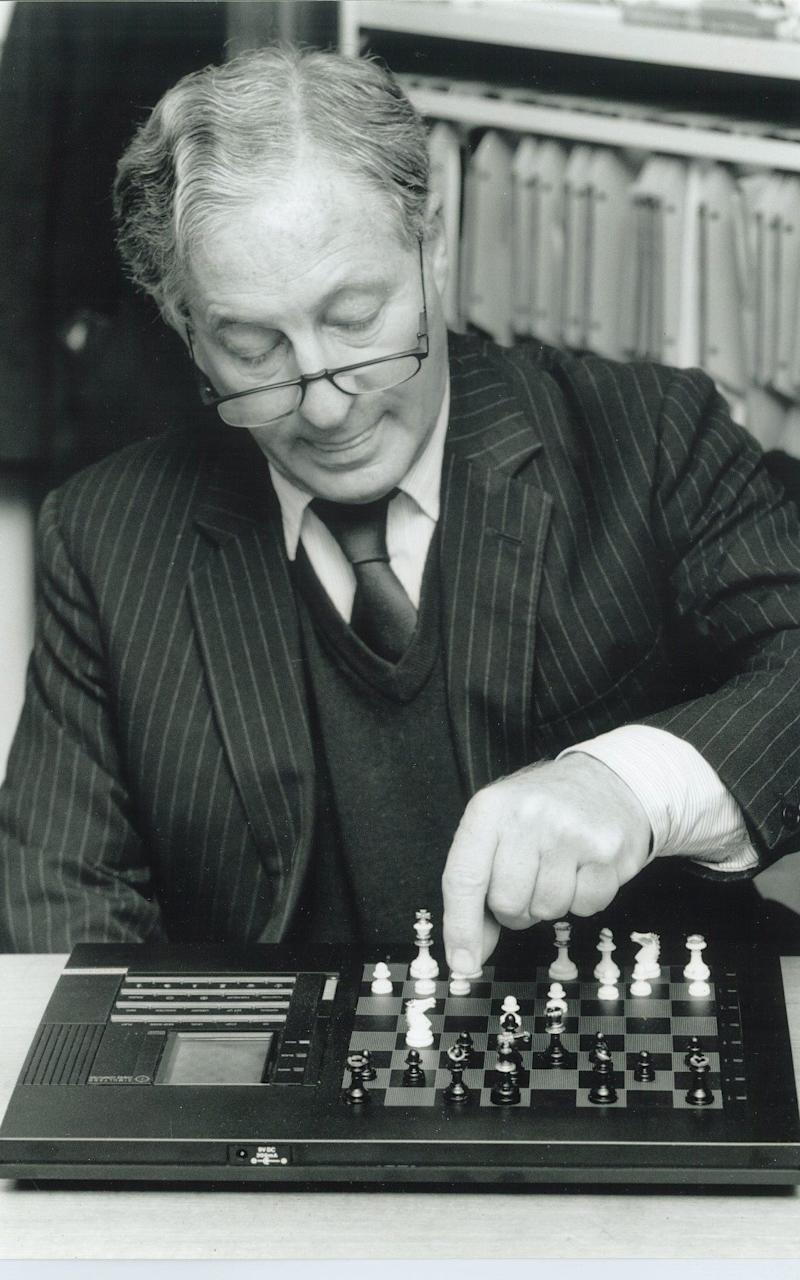 Anthony Curtis, former literary editor of the Sunday Telegraph, playing chess - Credit: Quentin Curtis