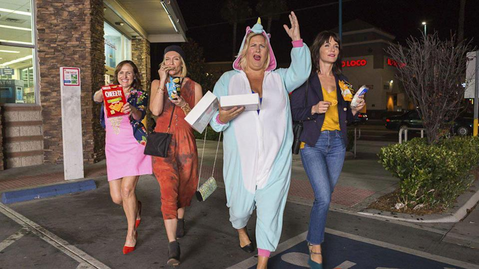 Molly Shannon, Toni Collette, Bridget Everett, and Katie Aselton in <em>Fun Mom Dinner</em> (Photo: Momentum Pictures)