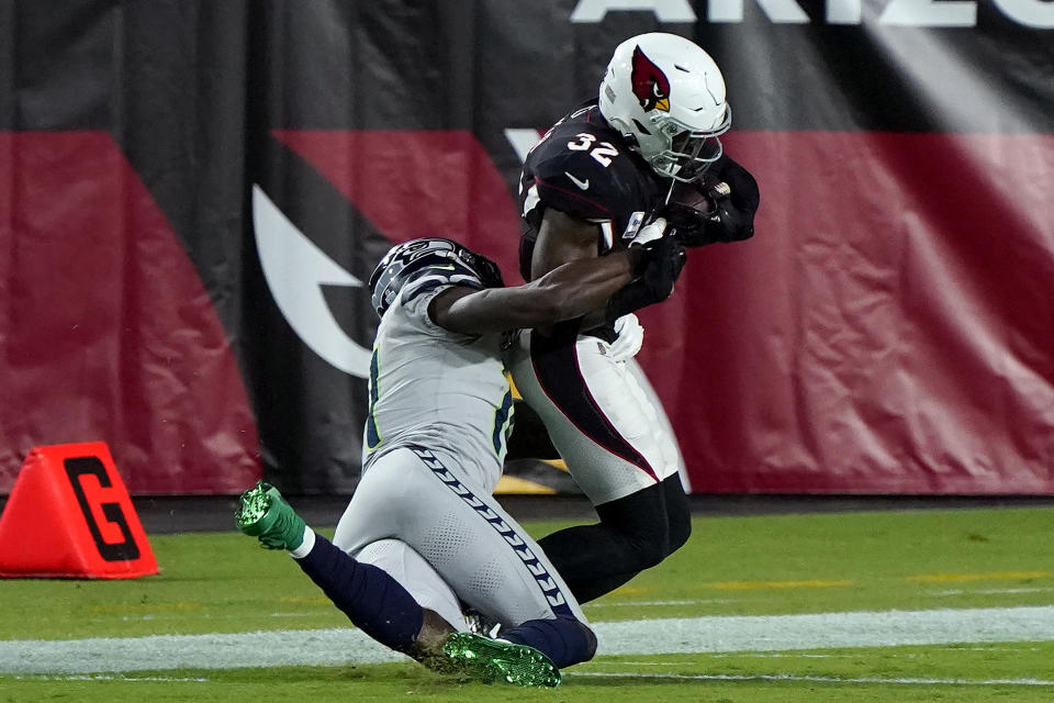 Seattle Seahawks wide receiver DK Metcalf tackles Arizona Cardinals strong safety Budda Baker (32) short of the goal line. (AP Photo/Rick Scuteri)
