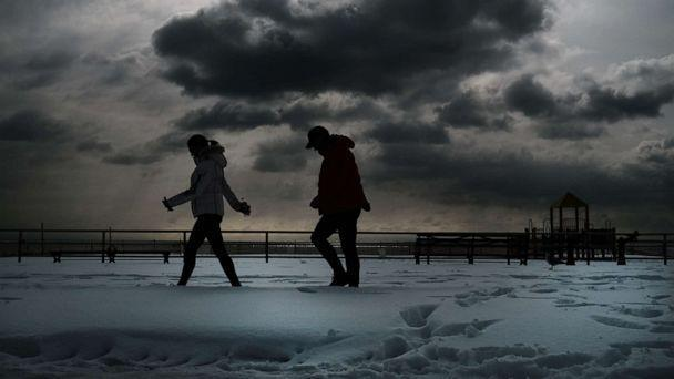 PHOTO: People walk through the snow at Coney Island on Feb. 3, 2021 in New York City.  (Spencer Platt/Getty Images)