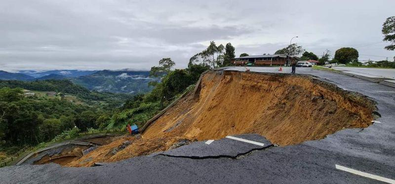 Part of the road in front of the entrance to the Kinabalu National Park, Malaysia's first World Heritage Site, has collapsed following unrelenting rain over the past few days. — Picture via Facebook