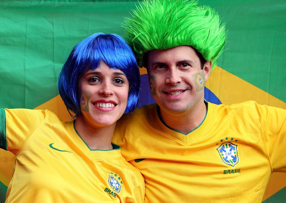 MANCHESTER, ENGLAND - AUGUST 07: Brazilian fans show support during the Men's Football Semi Final match between Korea and Brazil, on Day 11 of the London 2012 Olympic Games at Old Trafford on August 7, 2012 in Manchester, England. (Photo by Stanley Chou/Getty Images)