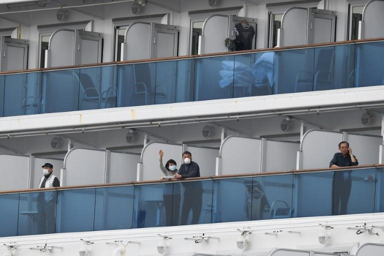 Those on board the Diamond Princess have been mostly confined to their cabins and required to wear masks and keep their distance from others during brief outings on deck (AFP Photo/CHARLY TRIBALLEAU)
