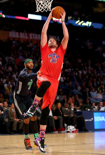 The Western Conference's Kevin Love #42 of the Minnesota Timberwolves heads for the net during 2014 NBA All-Star game at the Smoothie King Center on February 16, 2014 in New Orleans, Louisiana (AFP Photo/Ronald Martinez)