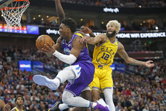 Utah Jazz guard Donovan Mitchell, left, goes to the basket as Golden State Warriors guard Ky Bowman (12) defends during the second half during an NBA basketball game Friday, Nov. 22, 2019, in Salt Lake City. (AP Photo/Rick Bowmer)