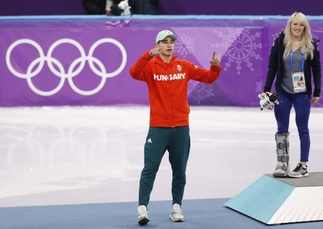 Short Track Speed Skating Events - Pyeongchang 2018 Winter Olympics - Men's 5000m Relay Final - Gangneung Ice Arena - Gangneung, South Korea - February 22, 2018 - Shaolin Sandor Liu of Hungary gestures as Elise Christie of Britain looks on after Hungary's team won gold. REUTERS/John Sibley
