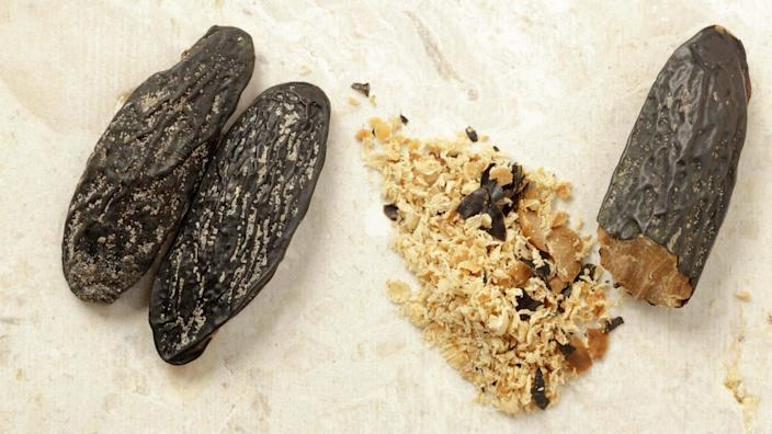 Mandatory Credit: Photo by Julie Woodhouse/imageBROKER/Shutterstock (9424087a)Tonka beans, whole and gratedVARIOUS.