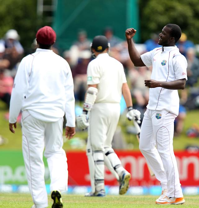 DUNEDIN, NEW ZEALAND - DECEMBER 03: Darren Sammy of the West Indies celebrates taking the wicket of Peter Fulton of New Zealand during day one of the first test match between New Zealand and the West Indies at University Oval on December 3, 2013 in Dunedin, New Zealand. (Photo by Rob Jefferies/Getty Images)