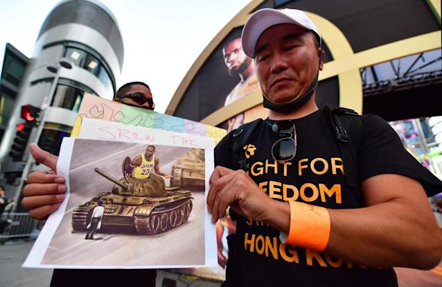 """<span class=""""element-image__caption"""">Anti-Chinese Communist Party activists protest outside Staples Center, home of the LA Lakers and Clippers, in the wake of the NBA's confrontation with China.</span> <span class=""""element-image__credit"""">Photograph: Frederic J Brown/AFP via Getty Images</span>"""