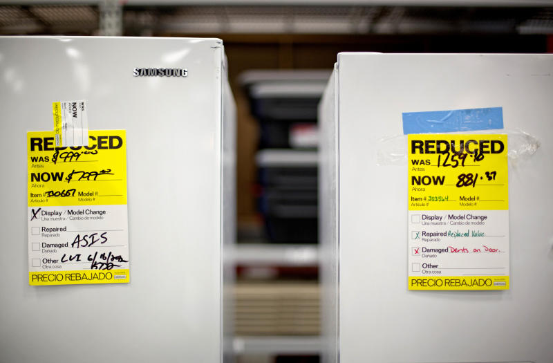 In this Tuesday, June 19, 2012 photo, price tags are seen on refrigerators on a showroom floor at Lowe's store in Atlanta. Companies cut back on orders for long-lasting U.S. factory goods last month, outside volatile aircraft and other transportation equipment. The decline suggests businesses are losing confidence in the economy. Orders for durable goods rose a seasonally adjusted 1.6 percent in June from May, the Commerce Department said Thursday, July 26, 2012. (AP Photo/David Goldman)