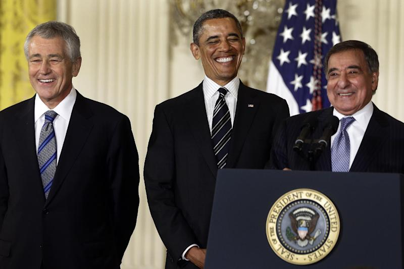 In this Jan. 7, 2013, file photo, President Barack Obama and his choice for Defense Secretary, former Nebraska Sen. Chuck Hagel, left, laugh as current Defense Secretary Leon Panetta speaks in the East Room of the White House in Washington, Monday, Jan. 7, 2013, where the president announced his nomination of Hagel. In 1989, former President Richard Nixon said unless a nominee is clearly unqualified, the Senate should respect the right of a president to fill his Cabinet. Nixon's words came during the bitter fight over President George H.W. Bush's choice of John Tower for the Pentagon post. The Democratic-led Senate rejected him. Now, Obama's choice of Hagel to be defense secretary will be a test for Senate Republicans, including those who fought strenuously for Tower. (AP Photo/Charles Dharapak, file)