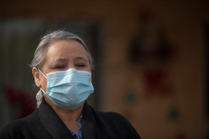 Maria Mendez had to suspend her annual plans of visiting family in her native Mexico after contracting COVID-19. She is photographed outside her home in Mecca as she quarantines in December.