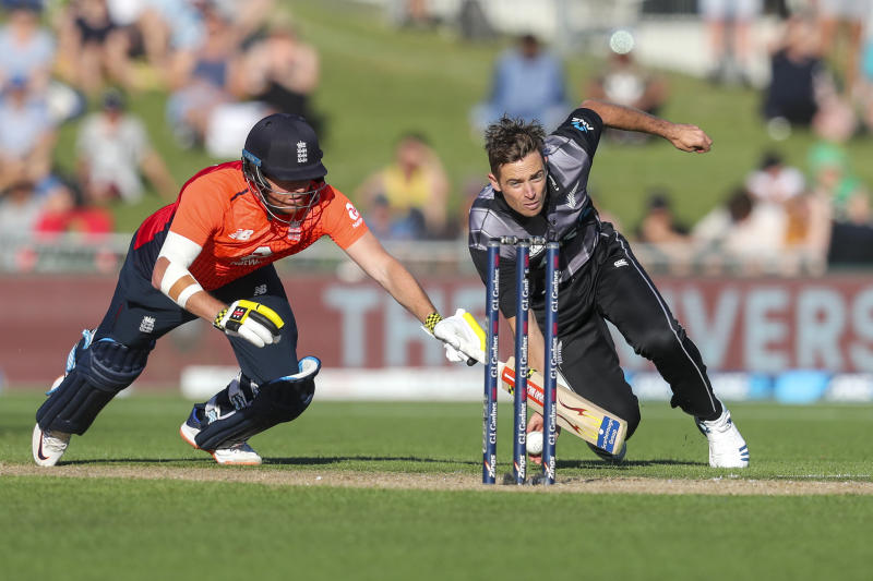New Zealand's Tim Southee tries to run out England's Jonny Bairstow during the T20 cricket match between England and New Zealand in Napier, New Zealand, Friday, Nov. 8, 2019. (John Cowpland/Photosport via AP)